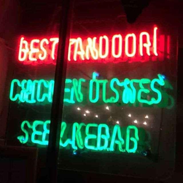 Neo sign saying Best Tandoori